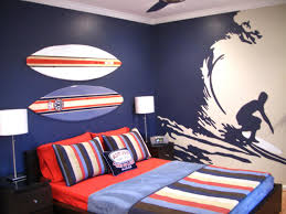 awesome boys bedroom ideas featuring cool wall painting and red queen size bed with colorful striped charming bedroom ideas red