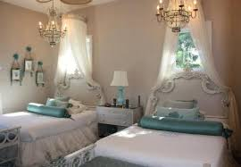 when it comes to bedroom lighting fixtures if one is pretty then two will be gorgeous we think thats definitely true of the unusual twin chandeliers in bedroom chandelier lighting