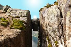 Image result for stuck between a rock and a hard place
