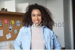 Smiling african gen z teen girl <b>bite candy</b> isolated on <b>pink</b> studio ...
