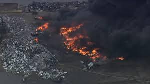 <b>Fire</b> at Jersey <b>City</b> scrapyard sends plumes of <b>black</b> smoke into sky ...