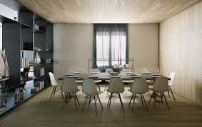 white modern dining room dark brown rounded wooden dining table round brown framed wall mirror white backrest dining chair black metal chandeliers white black wood dining room