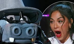 The Masked Singer unmasks its first contestant in premiere episode ...