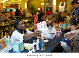 job seekers attend a job fair for seasonal work at a mall in the job seekers attend a job fair for seasonal work at a mall in the borough of queens in new york