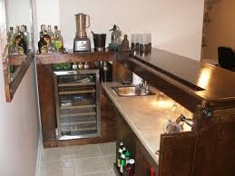 interior simple home bar design with warm interior nuance completed with top dark wooden table bar top lighting