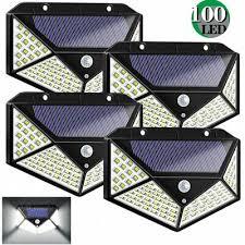 <b>4PCS 100 LED Solar</b> Power Wall Light Motion Sensor Waterproof ...