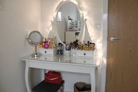 white wooden dressing table using best lighting for makeup vanity