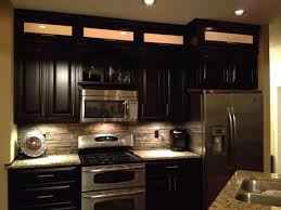 espresso cabinets light granite stacked rock backsplash with in cabinet and under backsplash lighting