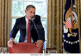 obama oval office president barack obama talks on the phone behind the oval office desk stock barack obama oval office