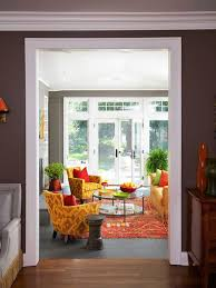 warm color schemes using red yellow and orange hues bhg living rooms yellow