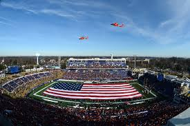 u s department of defense photo essay coast guard helicopters fly over navy marine corps memorial stadium at the start of the