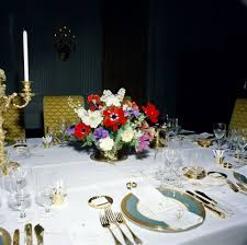 flower arrangements dining room table: flower arrangement and table settings in state dining room