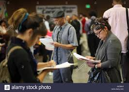 job seekers fill out applications during the th annual skid row job seekers fill out applications during the 11th annual skid row career fair the los angeles mission in los angeles california 31 2012