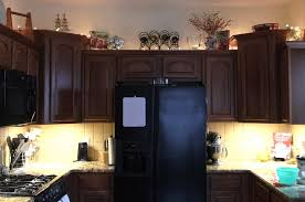after my son in law installed my under counter lighting featured here i decided i might kinda eventually want some lighting above my cabinets above cabinet lighting