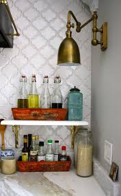 kitchen light fixture ideas using swing arm sconce with brass lamp shade above cooking oil bottle antique kitchen lighting