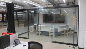 Office Space With Glass Partitions And Interior Frameless Door