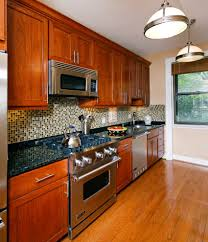 dark granite countertops kitchen contemporary with baseboards door handles drawer baseboards ceiling fan