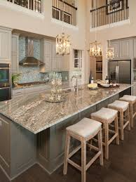 kitchen cabinets with granite countertops: learn more at gorgeous two story kitchen granite countertops pendant lighting blue mosaic backsplash tile grey cabinetry extra large island five star
