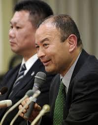 ... of Japan's national rugby team Eddie Jones (R) speaks before press in Tokyo on December 26, 2011, while new assistant coach Masahiro Kunda (L) looks on. - ---art_eddie_jones_20111227083032499252-420x0