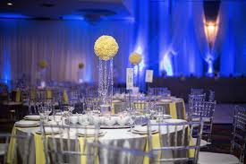 yellow and grey reception decor with blue uplighting blue wedding uplighting