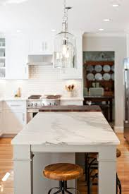 calacatta marble kitchen waterfall: honed calacatta gold marble the island countertop is honed calacatta gold marble honedcalacattagoldmarble