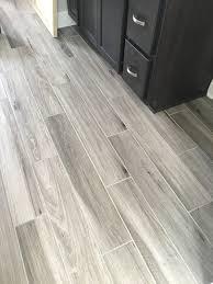 black bathroom tile light gray floor newly installed gray weathered wood plank tile flooring mudroom amp fo