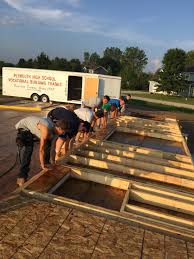 construction trades house for construction trade students raising a wall
