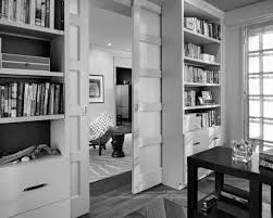 charming home office design with glossy wooden pocket doors and cool home library ideas nice home office decor black white marvelous large office desk awesome home library design