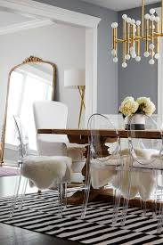 the dining table is surrounded by fur covered lucite chairs dining room ideas acrylic furniture lucite