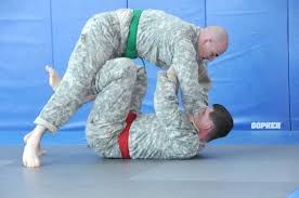 Staff Sgt. Stephen Cribben, USAG Baumholder, gets the advantage over Staff Sgt. - size0
