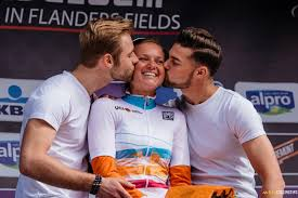female cyclist being kissed by podium boys