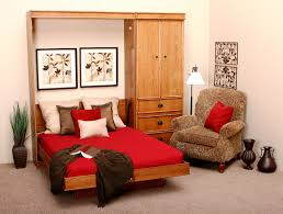 hideaway bed in a cabinet features polished oak wood murphy bed built in small wardrobe beds hideaway furniture ideas