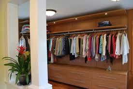 hip white interior column also open cabinetry feat clothes bar sleek walk in closet design storage architecture awesome modern walk closet
