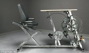 two friends have hand built a bicycle desk that generates electrical current as a worker bike office chair