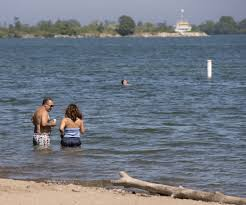the things you need to know about ontario s new smoking bans people swim in the water at cherry beach in toronto that could mean smoking in