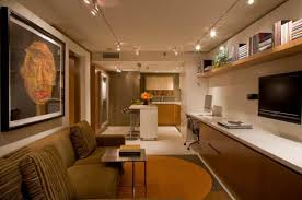 modern apartment kitchen with tracking lights and sofas and wall paintings full size basement track lighting