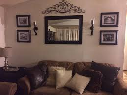 room wall mirrors behind couch wall in living room mirror frame sconces and metal decor