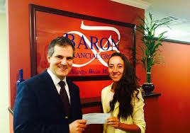 live event baron financial group llc baron financial group partner james shagawat presenting a scholarship award to ingrid faria of