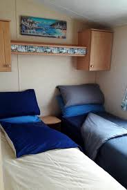 the ample bathroom facilites comprise of a shower room with a large enclosed shower cubicle extractor fan hand basin vanity cupboard heated towel rail ample shower room