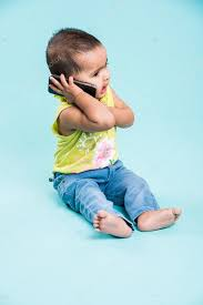 <b>Happy baby</b> girl talking on <b>mobile phone</b> isolated on blue. Closeup ...