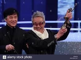 hong kong film producer willie chan chi keung r celebrates after hong kong film producer willie chan chi keung r celebrates after winning the professional achievement award at the 30th hong kong film awards 17