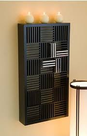 furniture the great design of cd holder for home with black color of wall cd storage for home on the brown wall with interesting white cream circle candles cds furniture