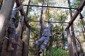 u s department of defense photo essay confidence course on after climbing a half wall the aid of a rope u s army infantry recruits