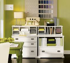storage solutions living room:  charming white living room storage combined with beautiful green orchid on olive green table