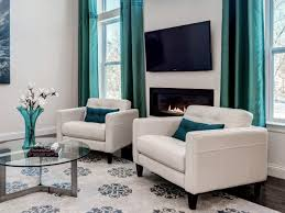 living room sofa ideas:  furniture latest living room furniture designs white carpet white sofa blue cushions round glass table