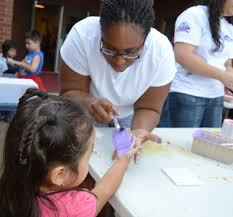 blue ridge school holds career day lowe s employee carletta anderson paints the hand of pre k student evelyn perez so she can put her imprint on a ceramic tile to commemorate career day