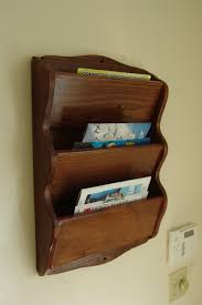 magazine rack wall mount:  wall mount magazine rack in bronze zoom