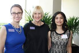 young women of promise d com from left athena society members julia gorzka man and cynthia gandee zinobar stand mira