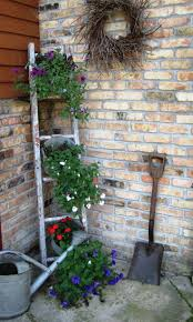 ladder garden structure decor ideas love using ladders with buckets filled with flowers