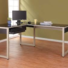 white polished steel based computer desk with black glass top having keyboard rack and apron placed black shaped office desks